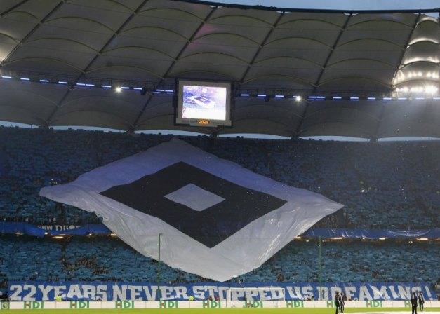 HAMBURG, GERMANY - APRIL 22:  Fans of Hamburg show banner during the DFB Cup Semi Final match between Hamburger SV and SV Werder Bremen at the HSH Nordbank Arena on April 22, 2009 in Hamburg, Germany.  (Photo by Joern Pollex/Bongarts/Getty Images)