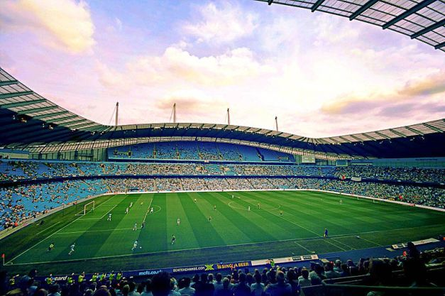 800px-city_of_manchester_stadium_east_stand
